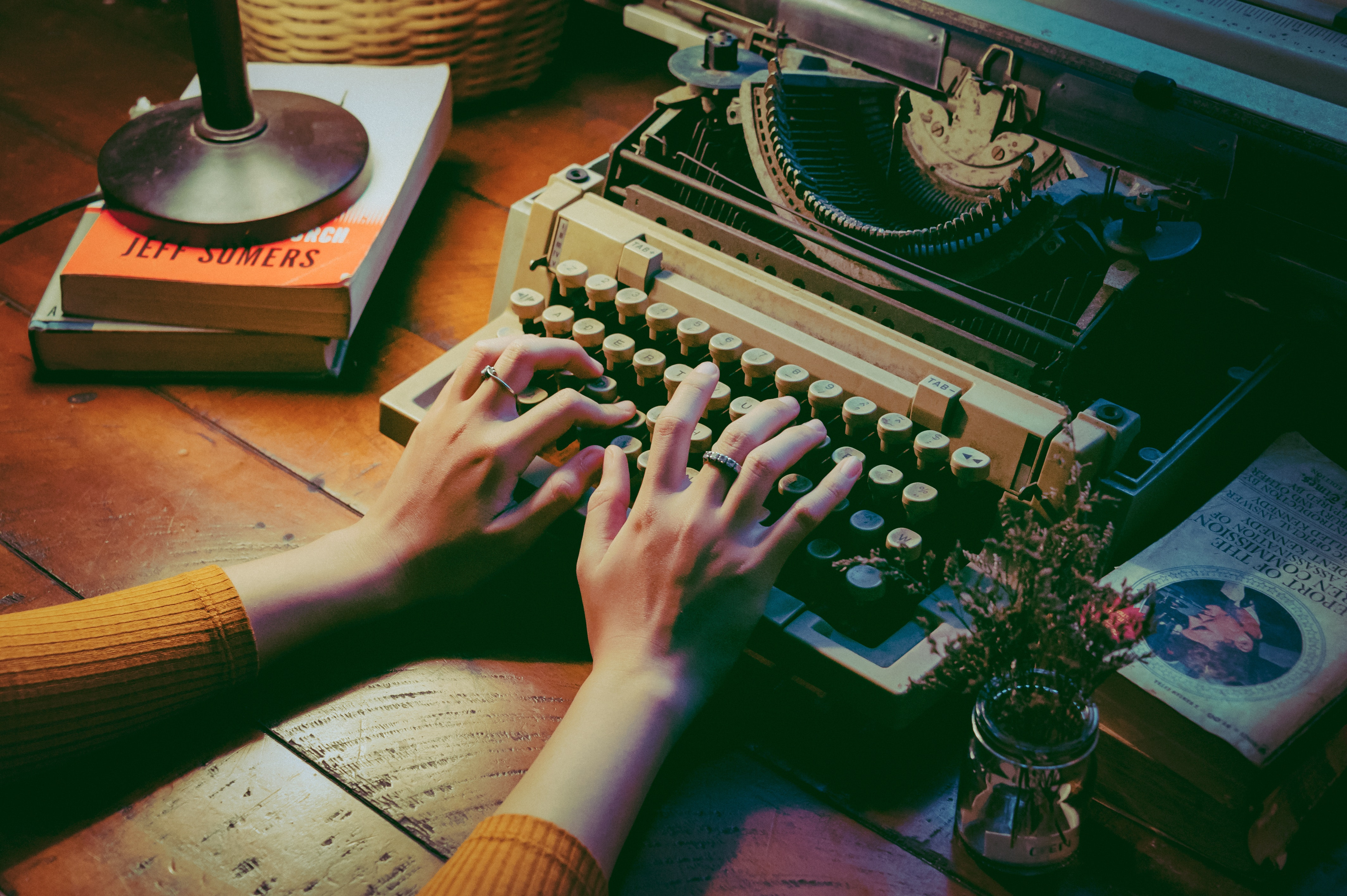 person-using-typewriter-1448709