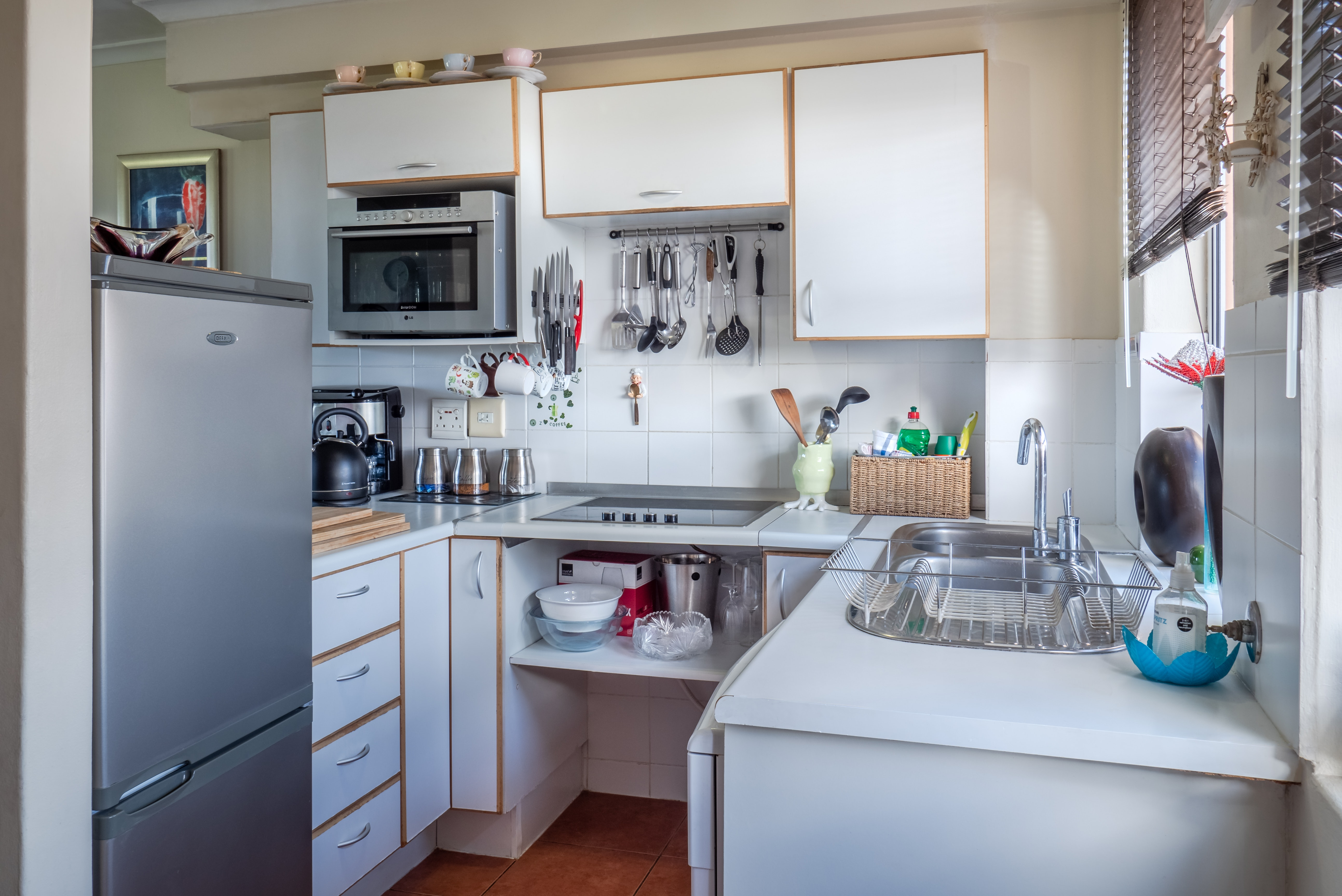 white-wooden-kitchen-cabinet-1599791