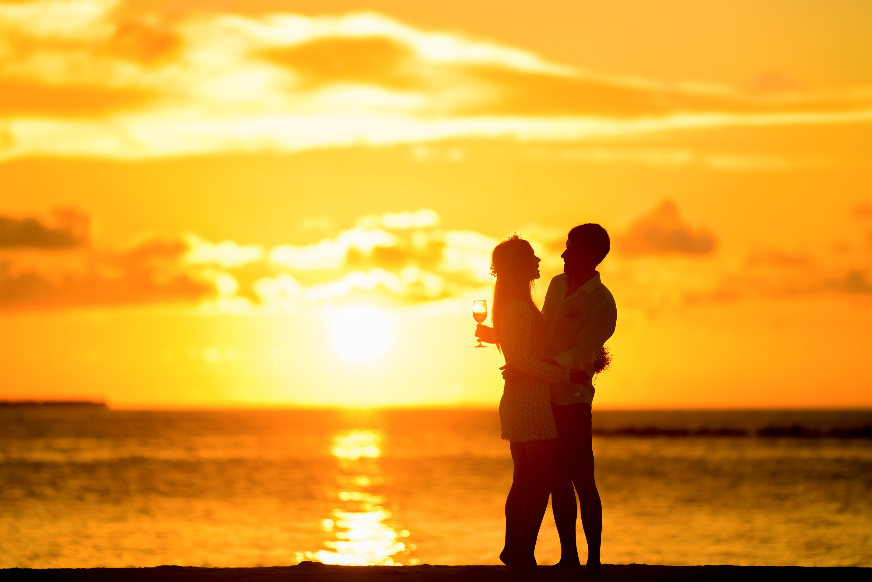couple-standing-in-the-seashore-hugging-each-other-during-169215