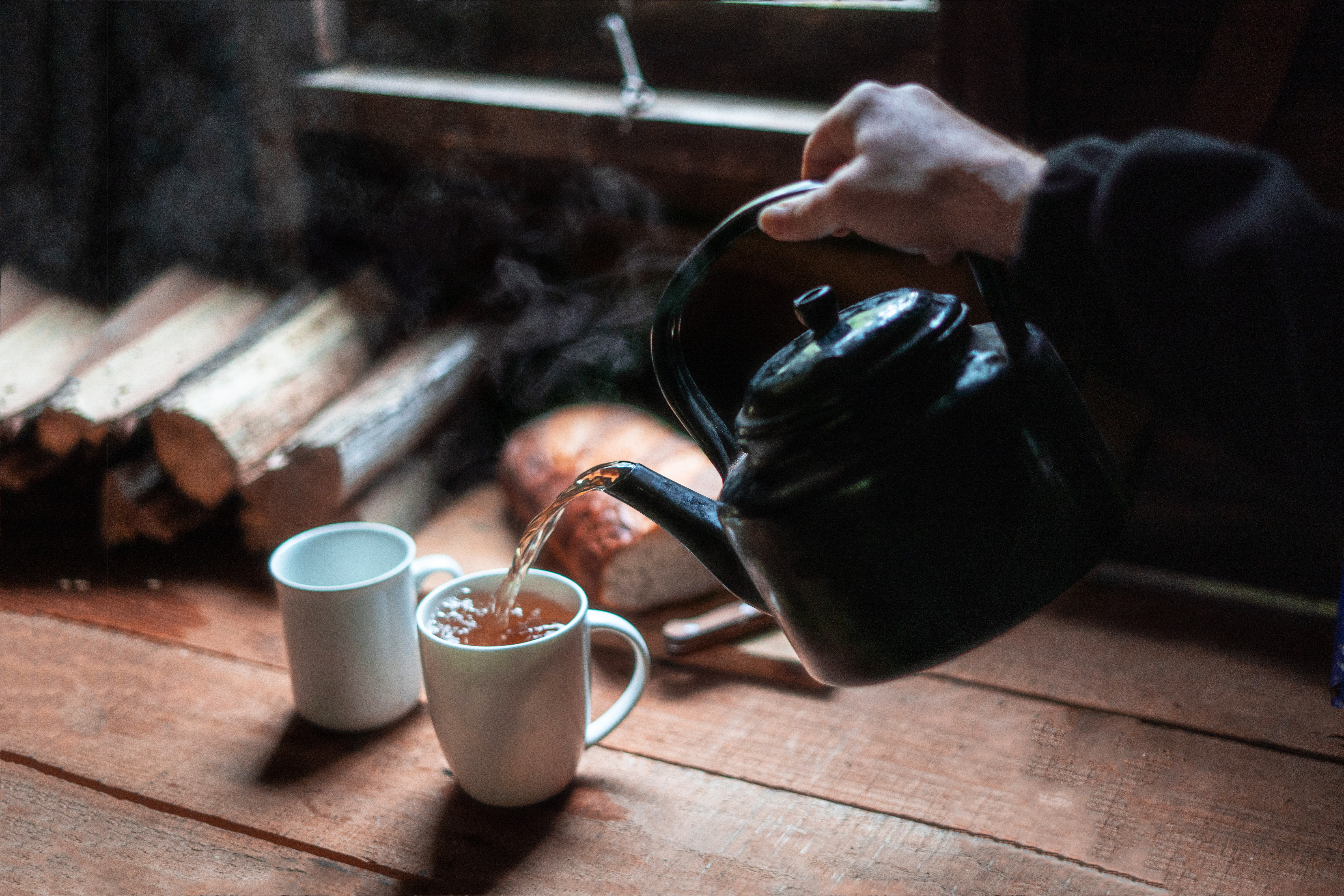 photo-of-person-pouring-hot-beverage-on-mug-3619784