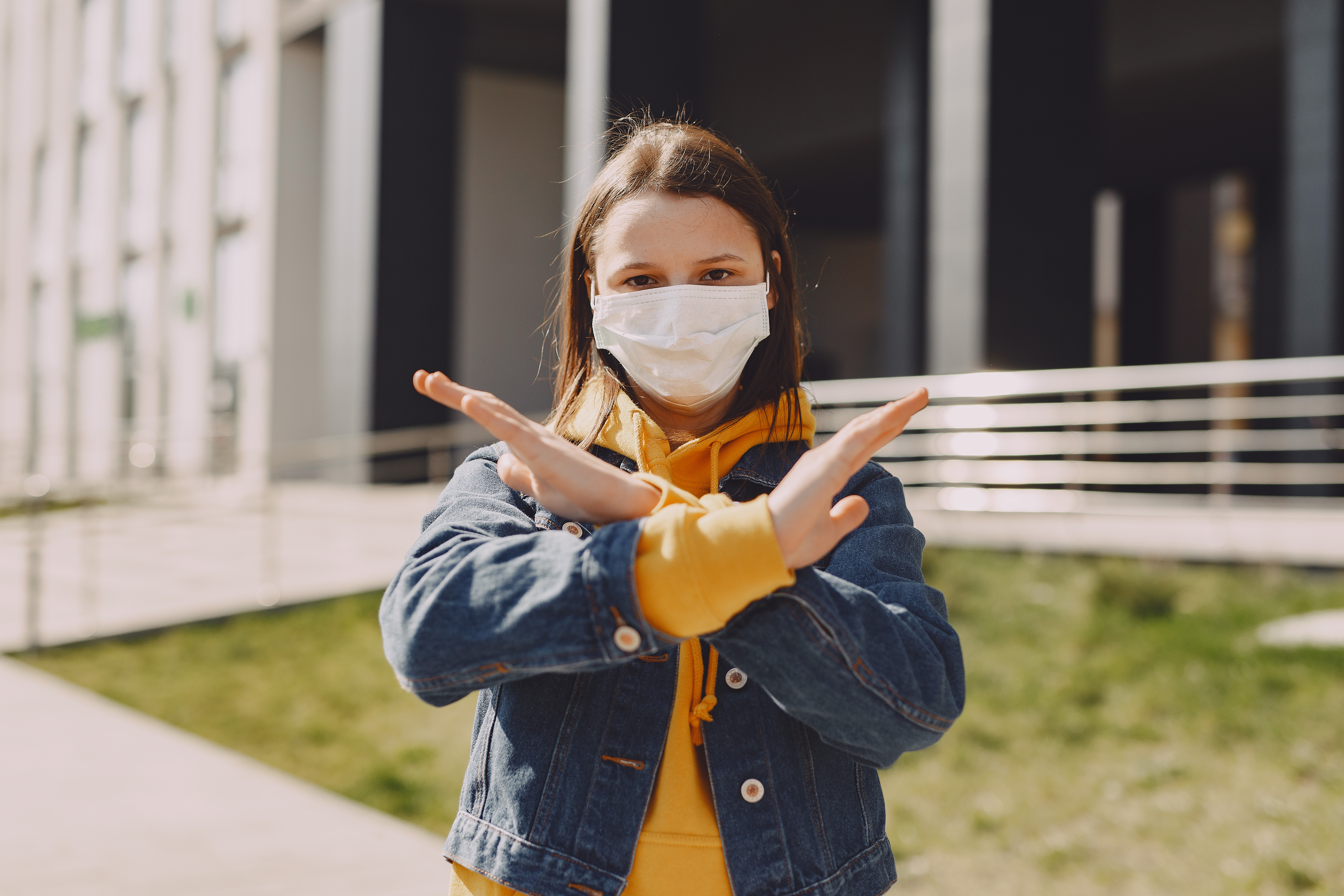 girl-in-medical-mask-showing-stop-looking-at-camera-4127429