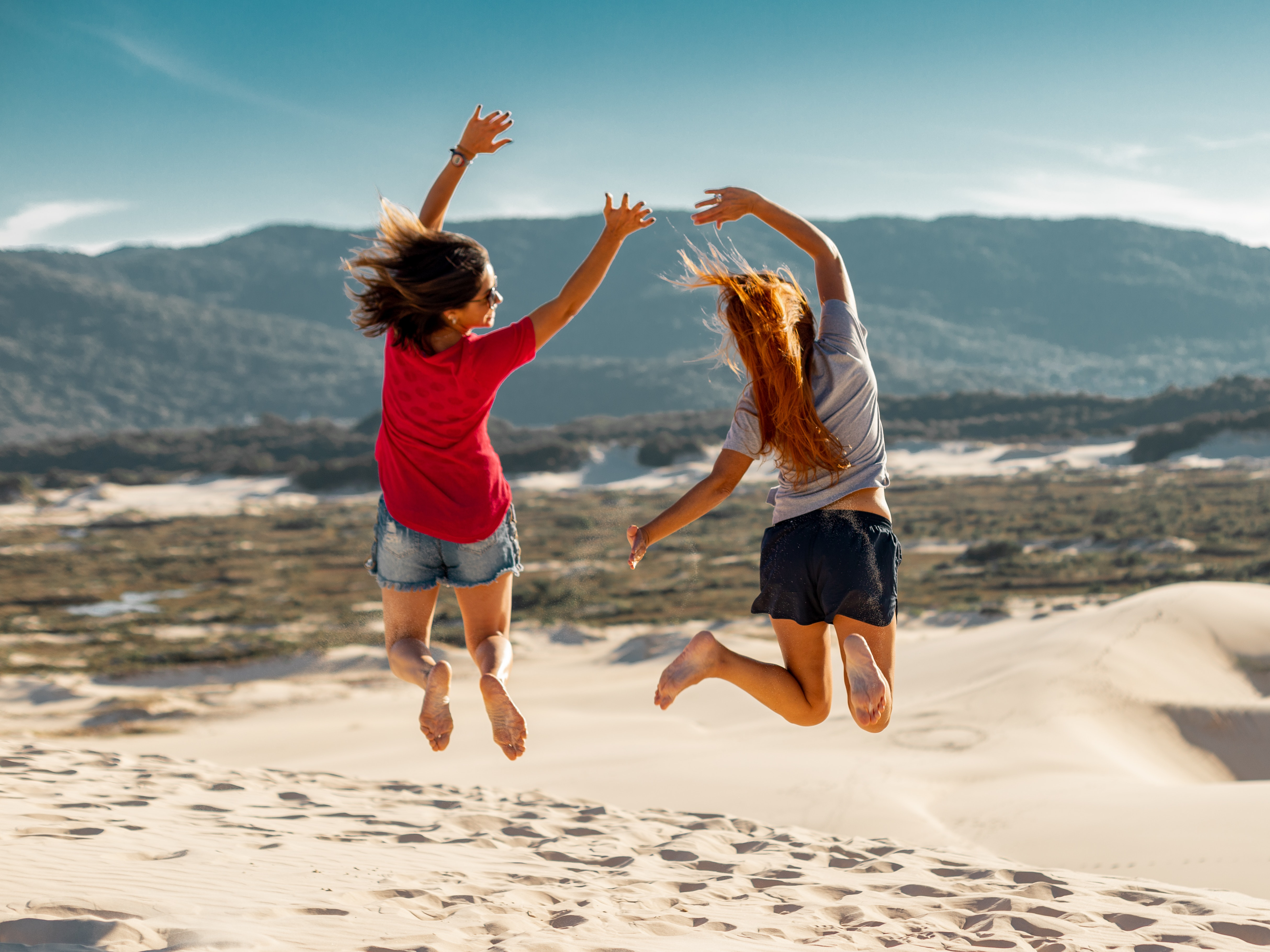 jump-shot-photography-of-two-women-2597365