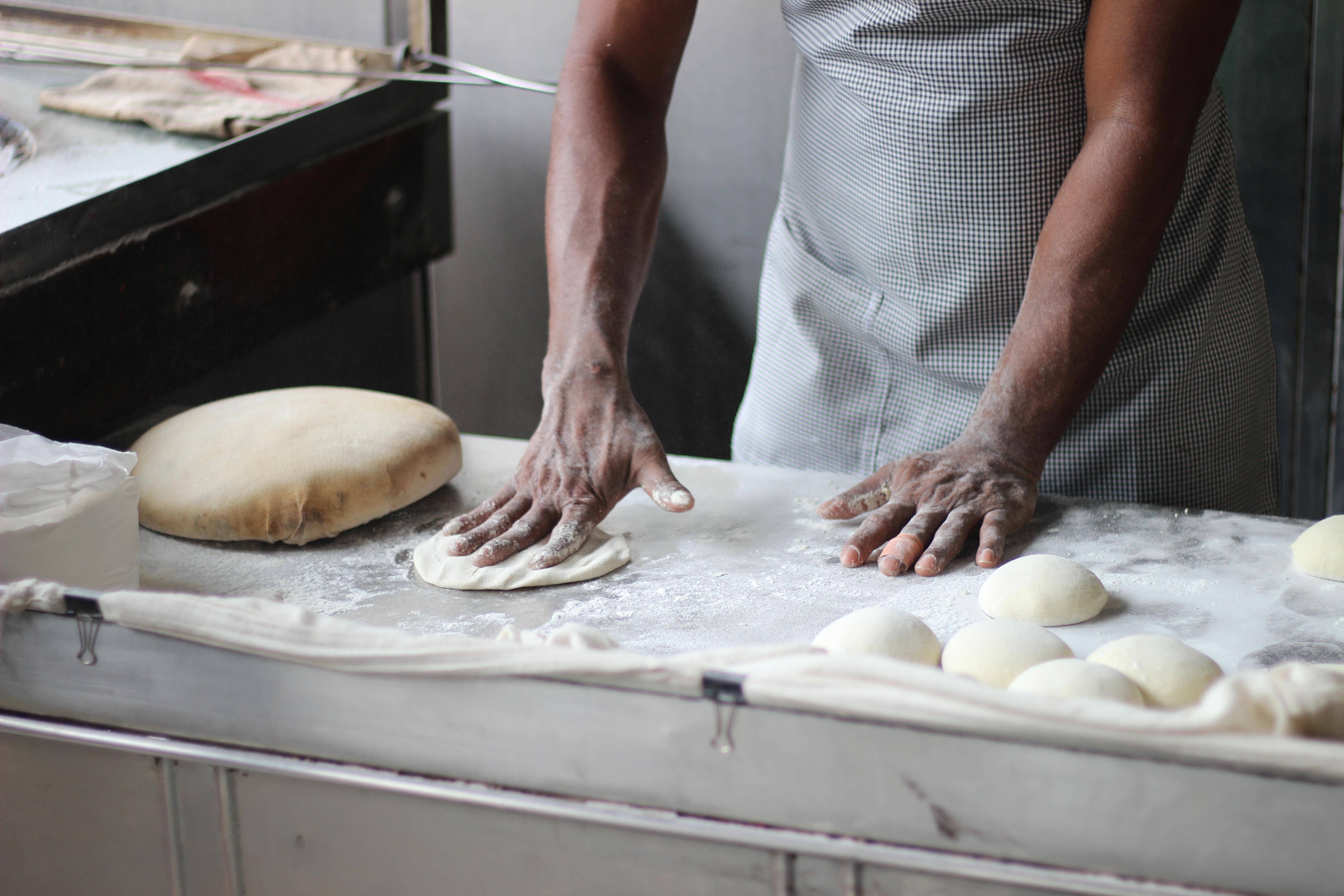 man-preparing-dough-for-bread-3218467