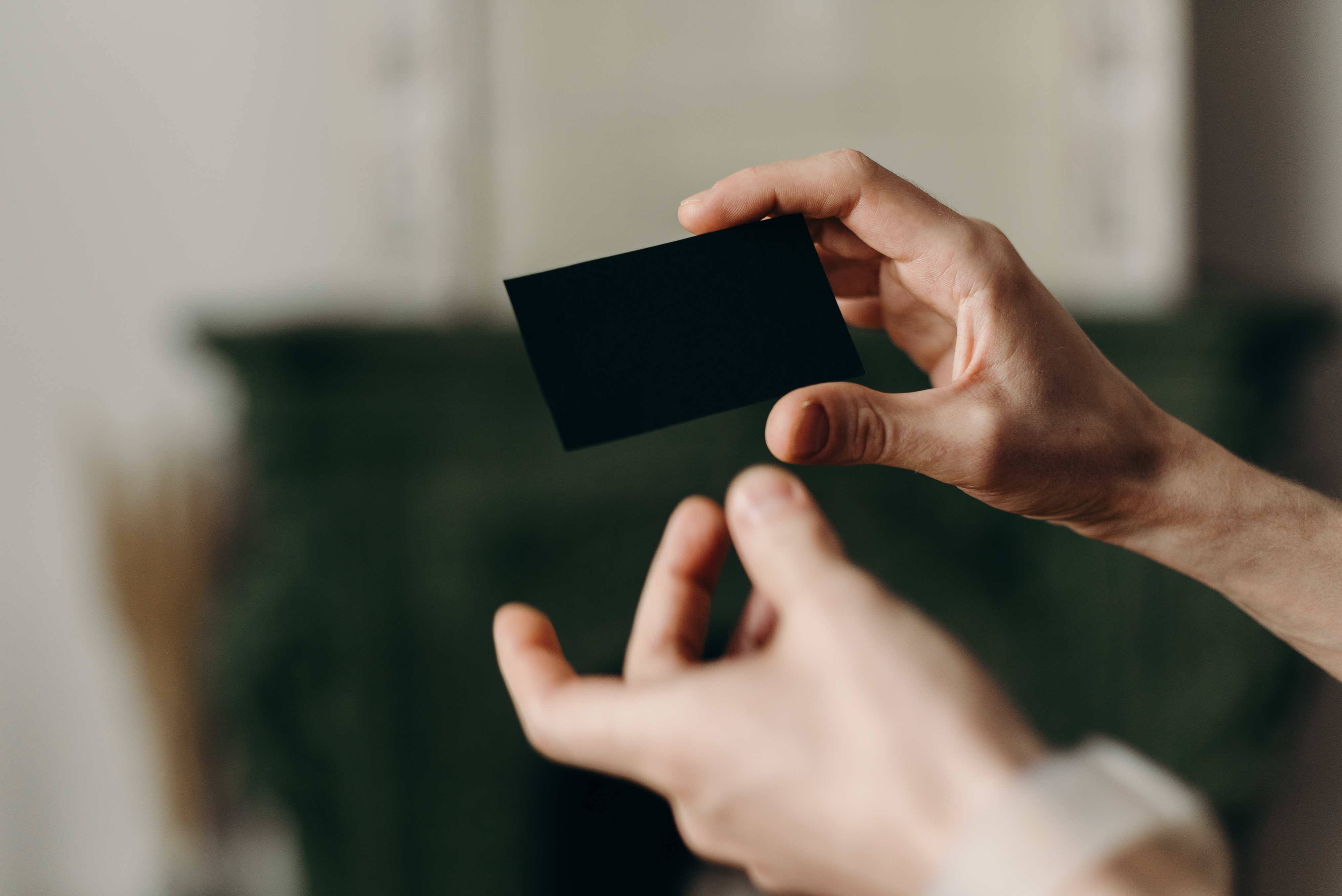 person-holding-black-card-4066291